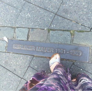 wall Berlin foot feet dress down sidewalk mauer Germany history marker toes division
